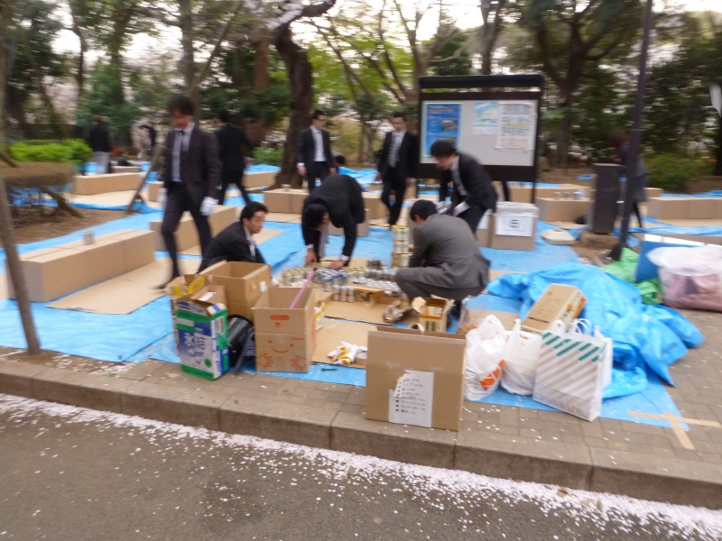 A lot of prep works goes into a good hanami party.  These guys are doing the dirty work to make the magic of drinking and cherry blossoms come to life.