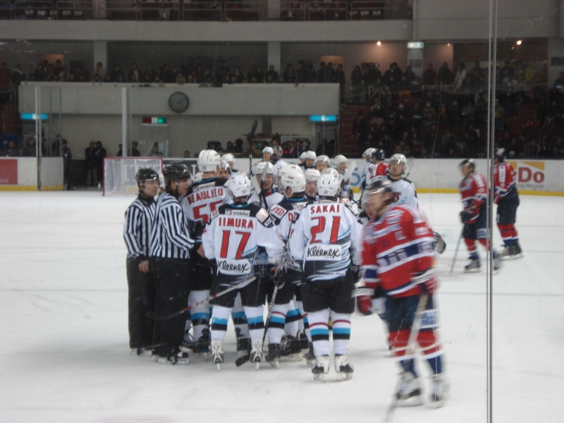In Japan, hockey isn't unheard of, but it isn't especially popular.  Like in America, hockey seems to be a regional sport in Japan.  It is played much more in the north and in the mountains than it is around Tokyo.  I caught a couple games that were